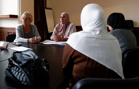 "Suzanne Anciaux and Nabila Mazouz, attend a meeting of ""Mothers' Jihad"", a group aiming to repatriate Belgian women and children held in Syrian refugee camps, in Antwerp, Belgium September 8, 2018. REUTERS/Francois Lenoir/File Photo"