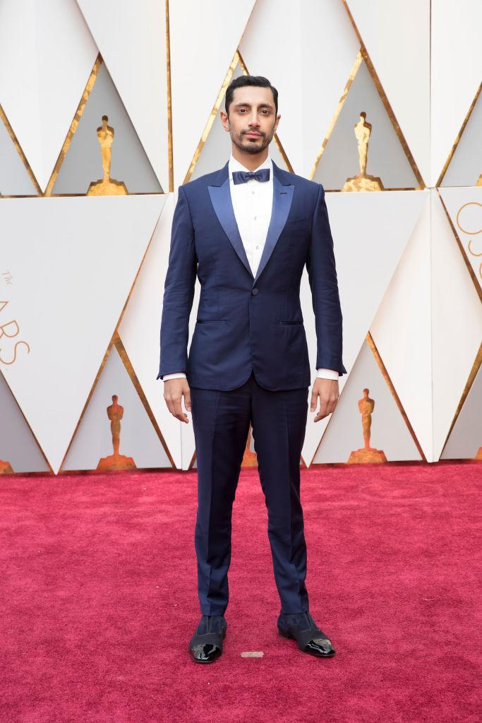 <p>Riz Ahmed went with varying shades of blue for his Oscars look. <em>(Photo: Getty Images)</em> </p>
