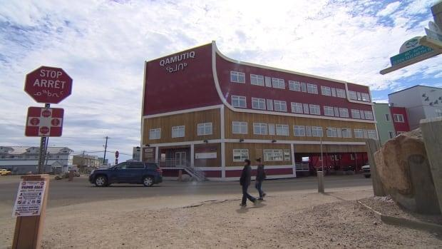 The view of the Qamutiq building from in front of Building 263. WhileCOVID-19 restrictions eased in Iqaluiton Thursday, the Nunavut health department said it will continue to carry out surveillance testing in the capital. (Vincent Robinet/CBC - image credit)