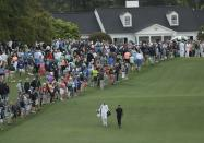 Si-Woo Kim, of South Korea, walks up the first fairway during a practice round for the Masters golf tournament Wednesday, April 4, 2018, in Augusta, Ga. (AP Photo/Matt Slocum)