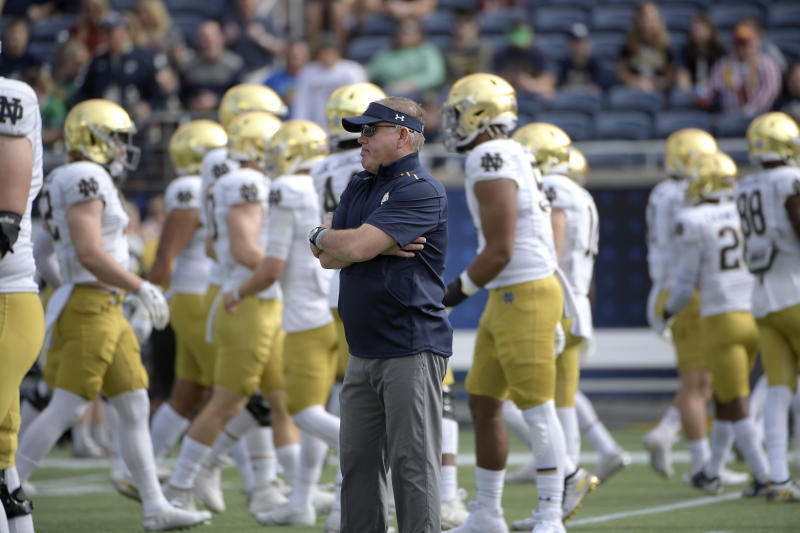 Notre Dame head coach Brian Kelly, center, watches warmups before the Camping World Bowl NCAA college football game against Iowa State Saturday, Dec. 28, 2019, in Orlando, Fla. (AP Photo/Phelan M. Ebenhack)