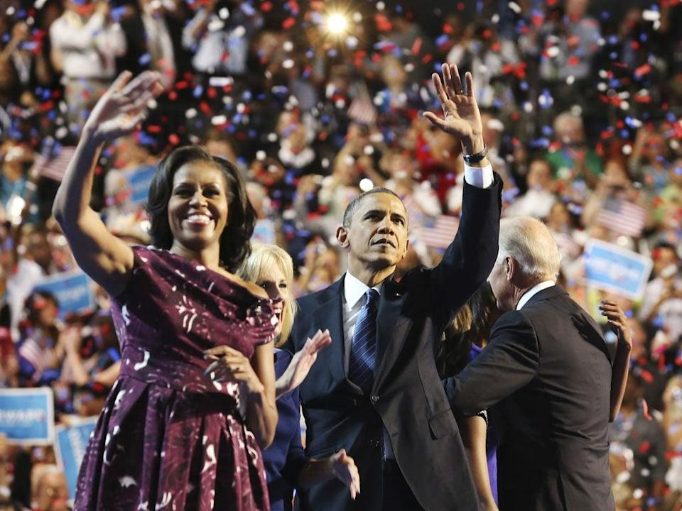 Barack and Michelle Obama wave to the crowd during the final session of the Democratic National Convention in Charlotte (Reuters)