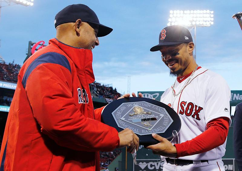 Boston Red Sox manager Alex Cora presents right fielder Mookie Betts with the 2018 AL MVP Award before a baseball game between the Red Sox and the Toronto Blue Jays on April 11, 2019, at Fenway Park in Boston.