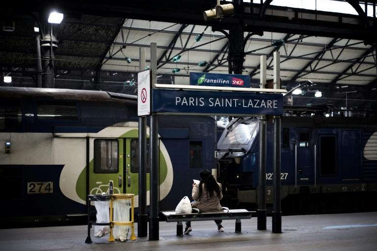 A commuter sits on a bench at the Gare Saint-Lazare in Paris in April 2018, as French rail workers launched another two-day strike over plans to overhaul the national state-owned railway company SNCF