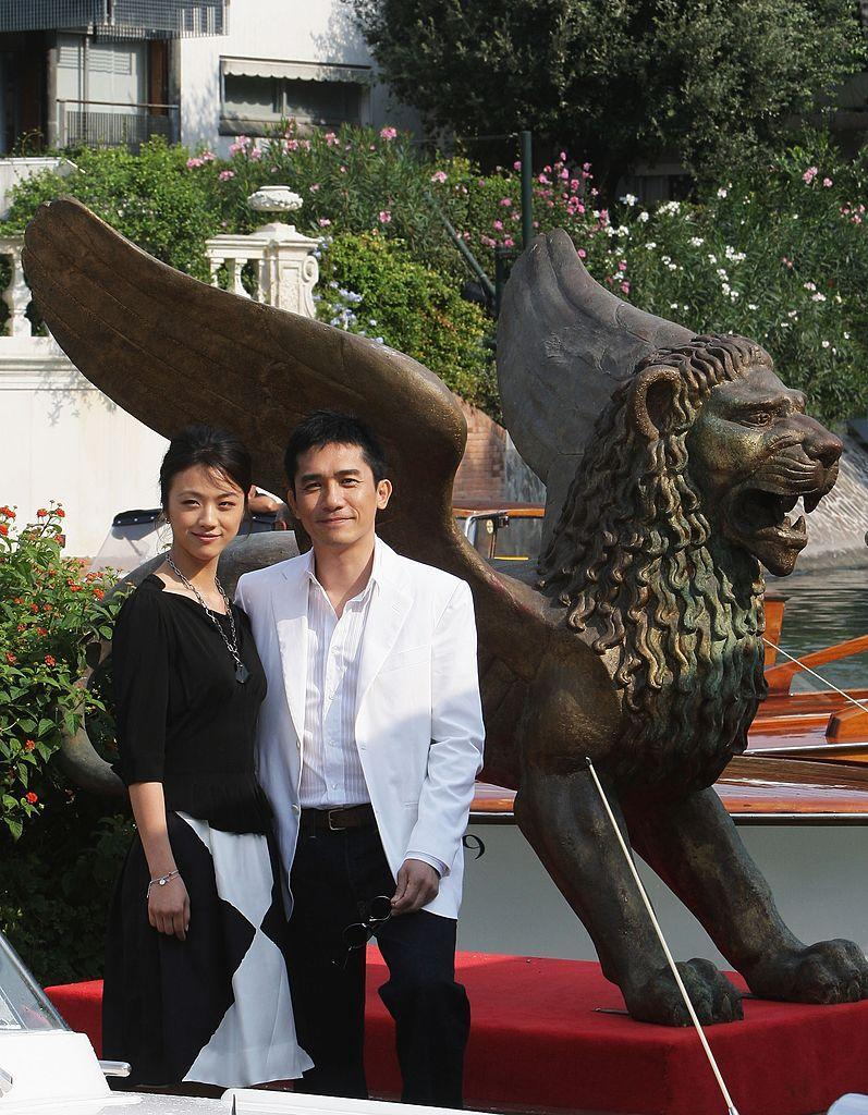 VENICE, ITALY - AUGUST 30: Actors Tang Wei and Tony Leung arrive in Venice during day 2 of the 64th Venice Film Festival on August 30, 2007 in Venice, Italy. (Photo by Franco Origlia/Getty Images)