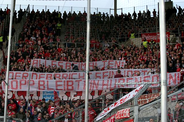 Bayern Munich fans unfurled this vulgar signage attacking Hoffenheim owner Dietmar Hopp. (Photo by Harry Langer/DeFodi Images via Getty Images)