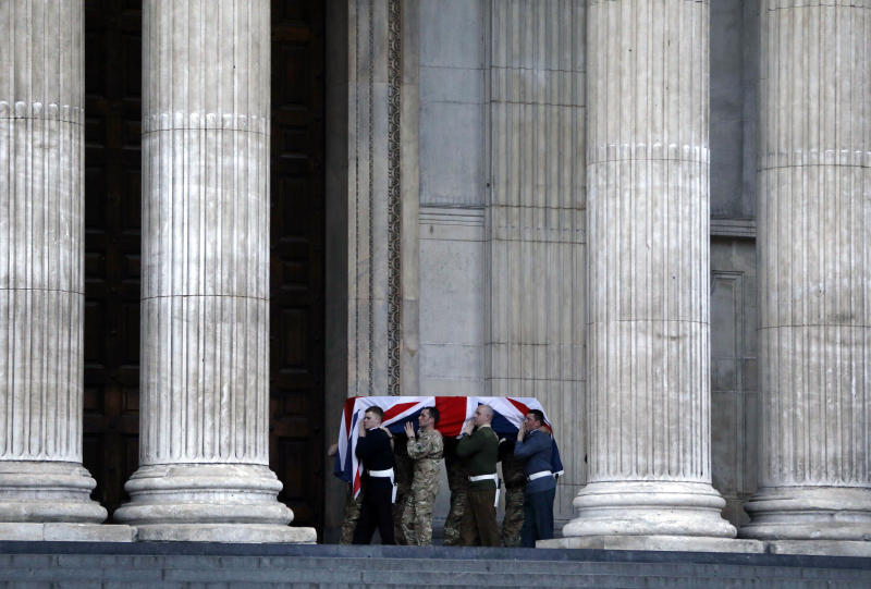 """British forces' officers carry a Union Jack-draped coffin outside St Paul's Cathedral in central London early Monday, April 15, 2013 during the rehearsal for the upcoming funeral of former British Prime Minister Margaret Thatcher. Thatcher, the combative """"Iron Lady"""" who infuriated European allies and transformed her country by a ruthless dedication to free markets in 11 bruising years as prime minister, died Monday, April 8, 2013. The funeral will take place Wednesday, April 17, 2013. (AP Photo/Lefteris Pitarakis)"""