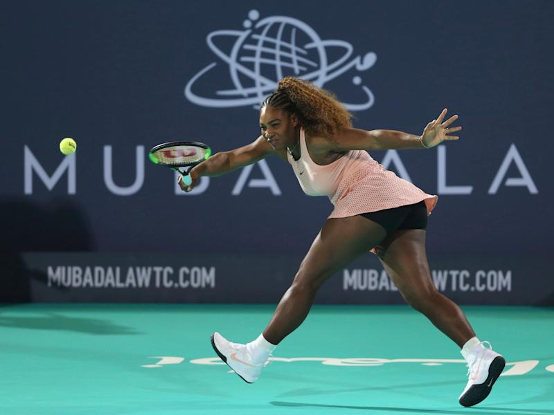 Serena Williams returns the ball to her sister Venus during a match at the opening day of the Mubadala World Tennis Championship in Abu Dhabi, United Arab Emirates on Dec. 27. (Photo: ASSOCIATED PRESS)
