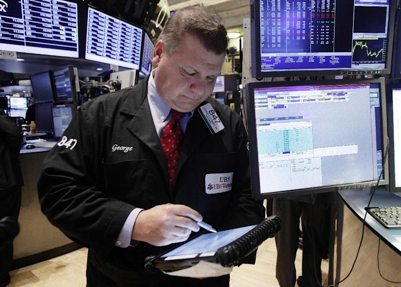 Trader George Ettinger works on the floor of the New York Stock Exchange Tuesday, Dec. 11, 2012. Stocks opened higher Tuesday ahead of a meeting of the Federal Reserve and possible additional steps to bolster the U.S. economy. (AP Photo/Richard Drew)