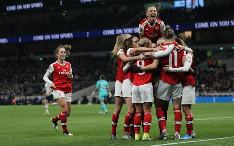 Arsenal's players celebrate after Vivianne Miedema put the result beyond doubt - PA