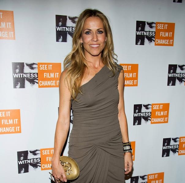 "FILE - In this Dec. 2, 2010 file photo, Sheryl Crow attends the 6th Annual Focus for Change: Benefit Dinner and Concert in support of the human rights group Witness, in New York. The musical based on the film ""Diner"" has postponed its Broadway opening. Producers said late Sunday night, Jan. 6, 2013, that the Kathleen Marshall-directed show with songs by Sheryl Crow will make its debut on Broadway in the fall, instead of the spring. (AP Photo/Charles Sykes, File)"