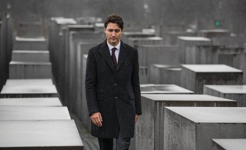 """Canadian Prime Minister Justin Trudeau has been called the """"anti-Trump"""" in a German newspaper, while at home, supporters on the left have bit their tongue as he renews neighborly ties with the Republican (AFP Photo/Odd ANDERSEN)"""