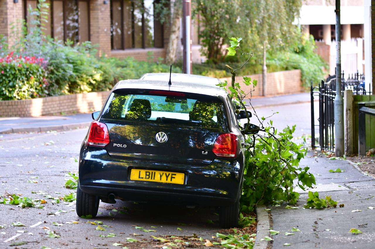 <p>A car lays under a fallen tree branch in Cambridge as Storm Aileen is set to bring winds of up 75 miles per hour to parts of the UK this week, according to the Met Office. Aileen is the first storm to be named since this season's names were released last week, as part of the scheme by the Met Office and Met Eireann to raise awareness of extreme weather in the UK and Ireland. (SWNS.com) </p>