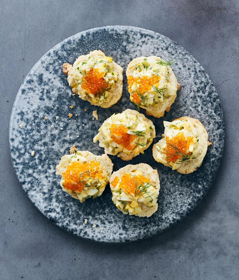 """The bright roe adds a salty pop to these small breakfast bites. <a href=""""https://www.bonappetit.com/recipe/deviled-eggs-on-biscuits-with-trout-roe-and-dill?mbid=synd_yahoo_rss"""" rel=""""nofollow noopener"""" target=""""_blank"""" data-ylk=""""slk:See recipe."""" class=""""link rapid-noclick-resp"""">See recipe.</a>"""