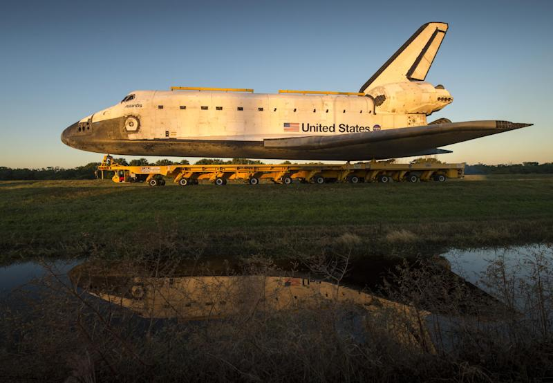 Space shuttle Atlantis rolls down Kennedy Parkway on its way to its new home at the Kennedy Space Center Visitor Complex, Friday, Nov. 2, 2012, in Cape Canaveral, Fla.  The spacecraft traveled 125,935,769 miles during 33 spaceflights, including 12 missions to the International Space Station. Its final flight, STS-135, closed out the Space Shuttle Program era with a landing on July 21, 2011. (AP Photo/NASA, Bill Ingalls)