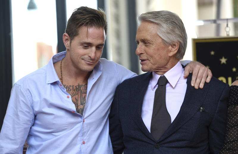 Honoree and actor Michael Douglas, right, poses with his son actor Cameron Douglas following a ceremony honoring him with a star on the Hollywood Walk of Fame on Tuesday, Nov. 6, 2018, in Los Angeles. (Photo by Chris Pizzello/Invision/AP)