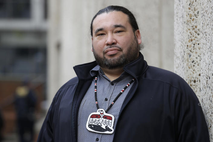 FILE - In this Nov. 14, 2019, file photo, Makah Tribe Vice Chairman Patrick DePoe poses for a photo before a federal hearing to help determine whether his small American Indian tribe from Washington state can once again hunt whales in Seattle. Nearly two years after the hearing, an administrative law judge on Thursday, Sept. 23, 2021, recommended that the Makah be allowed to resume whaling along the coast as their ancestors did. (AP Photo/Elaine Thompson, File)
