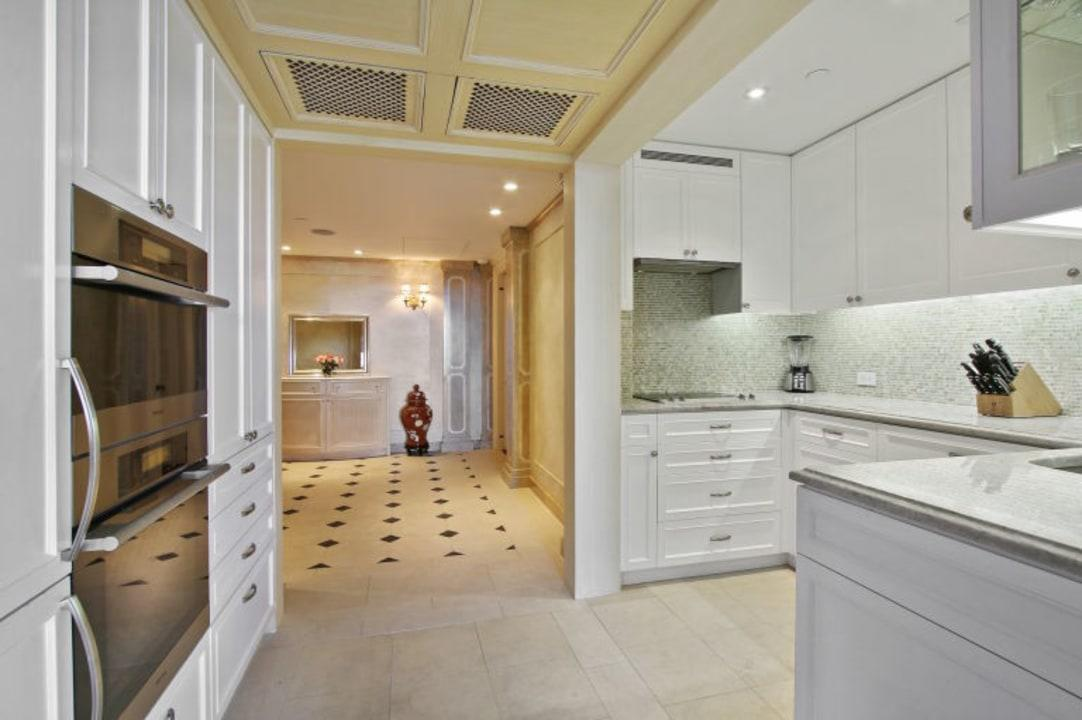 The kitchen is renovated with top-of-the-line appliances, though, considering they had room service at their fingertips, who knows how much cooking the couple did.