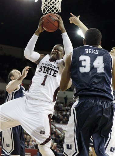 Mississippi State forward Renardo Sidney (1) fights for a rebound past Utah State defenders including forward Kyisean Reed (34) in the first half of their NCAA college basketball game in Starkville, Miss., Saturday, Dec. 31, 2011. (AP Photo/Rogelio V. Solis)