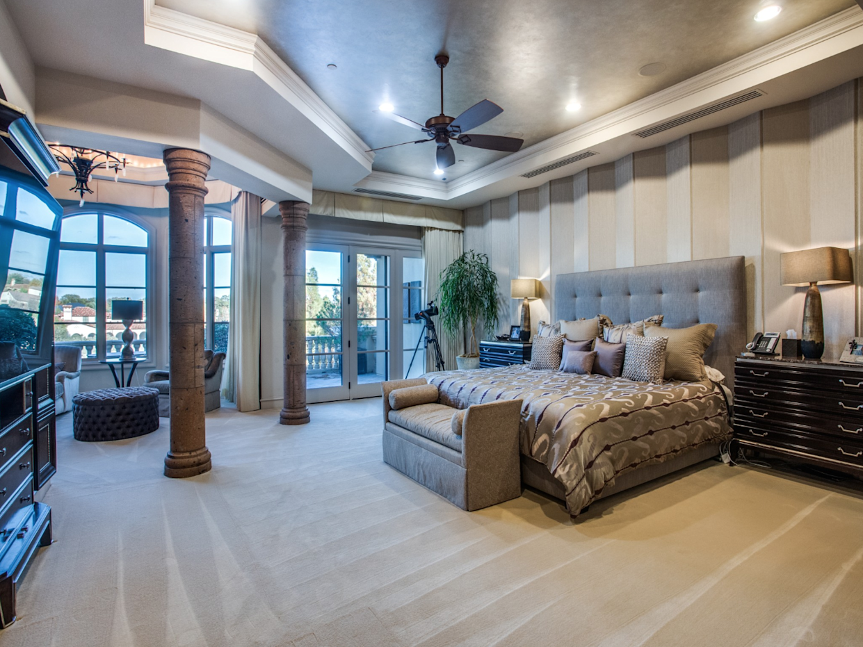 """<div class=""""caption""""> The master bedroom. </div> <cite class=""""credit"""">Photo: Couresty of Shoot2Sell photography</cite>"""