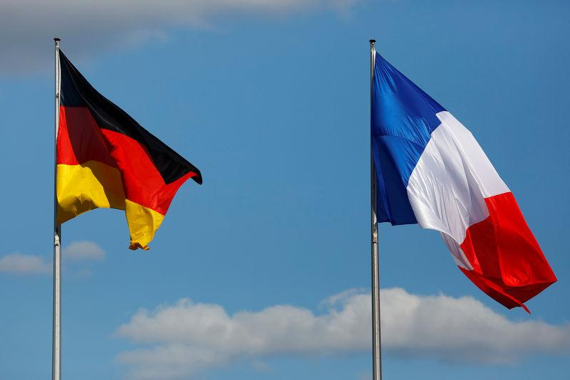 The flags of Germany and France are seen in front of the the Chancellery, before the meeting between German Chancellor Angela Merkel and French President Emmanuel Macron in Berlin