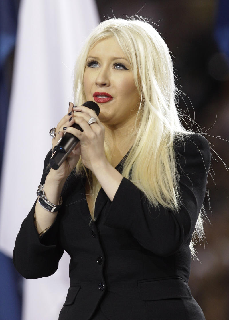 Christina Aguilera sings the national anthem before the NFL football Super Bowl XLV game between the Green Bay Packers and the Pittsburgh Steelers on Sunday, Feb. 6, 2011, in Arlington, Texas. (AP Photo/David J. Phillip)