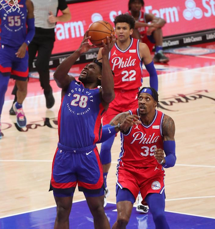Detroit Pistons center Isaiah Stewart shoots against Philadelphia 76ers center Dwight Howard during the first quarter at Little Caesars Arena, Saturday, Jan. 23, 2021.