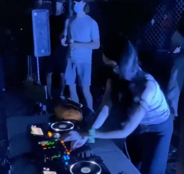A DJ spins a record during a pandemic rave at Riverdale Park. Police say roughly 200 people were in attendance Friday night. (Instagram - image credit)