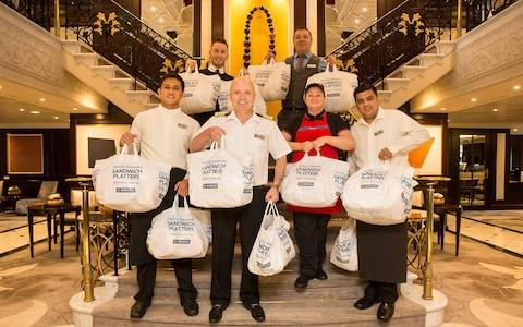 cruise staff holding greggs bags - Credit: Port of Tyne
