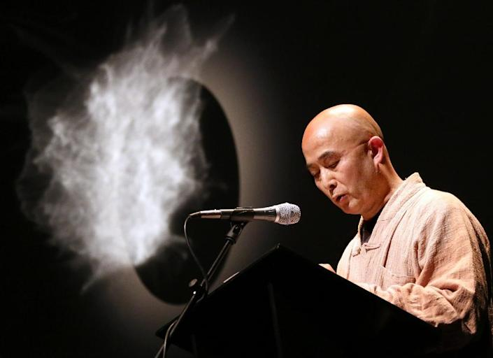Liao is a poet and musician who also reported on the lives of the Chinese poor (AFP Photo/STEPHANIE PILICK)