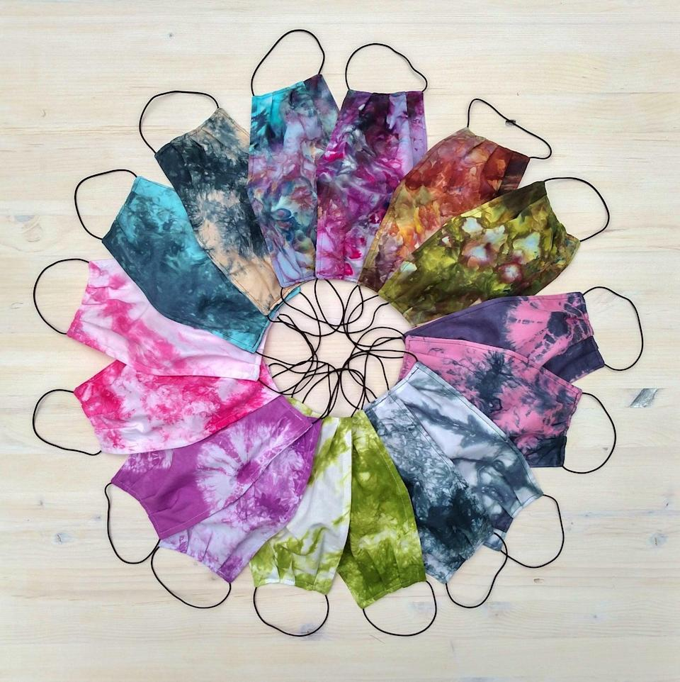 """<p>This <a href=""""https://www.popsugar.com/buy/Reversible-Tie-Dye-Face-Mask-575572?p_name=Reversible%20Tie%20Dye%20Face%20Mask&retailer=etsy.com&pid=575572&price=13&evar1=fit%3Aus&evar9=47488672&evar98=https%3A%2F%2Fwww.popsugar.com%2Ffitness%2Fphoto-gallery%2F47488672%2Fimage%2F47488676%2FReversible-Tie-Dye-Face-Mask&list1=face%20masks%2Cworkouts%2Ccoronavirus&prop13=api&pdata=1"""" class=""""link rapid-noclick-resp"""" rel=""""nofollow noopener"""" target=""""_blank"""" data-ylk=""""slk:Reversible Tie Dye Face Mask"""">Reversible Tie Dye Face Mask</a> ($13) is simple but gets the job done. The fabric is 100 percent cotton, so it's breathable but will still keep you and others protected.</p>"""