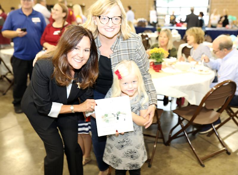 Karen Pence signs one of her books for Claire and Julie Van de Hoef during a fundraiser for Iowa Gov. Kim Reynolds on Sept. 21 in Des Moines.