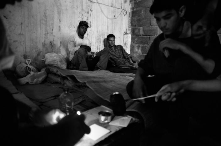 A group of Algerian kids cooking inside the abandoned factory where they live in the Spanish enclave of Ceuta 2005. (Photo: José Colón/MeMo for Yahoo News)