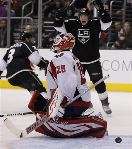 Washington Capitals goalie Tomas Vokoun reacts to Los Angeles Kings defenseman Jack Johnson's, left, goal as Andrei Loktionov celebrates during the second period of an NHL hockey game in Los Angeles, Monday, Jan. 9, 2012. (AP Photo/Chris Carlson)