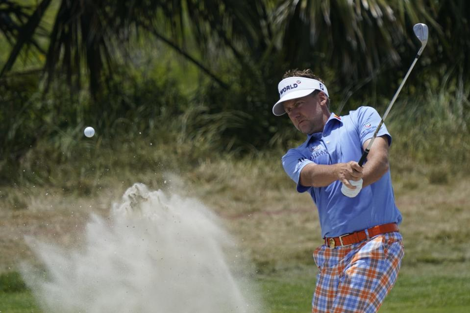 Ian Poulter, of England, works in the bunker on the fourth hole during the third round at the PGA Championship golf tournament on the Ocean Course, Saturday, May 22, 2021, in Kiawah Island, S.C. (AP Photo/Matt York)