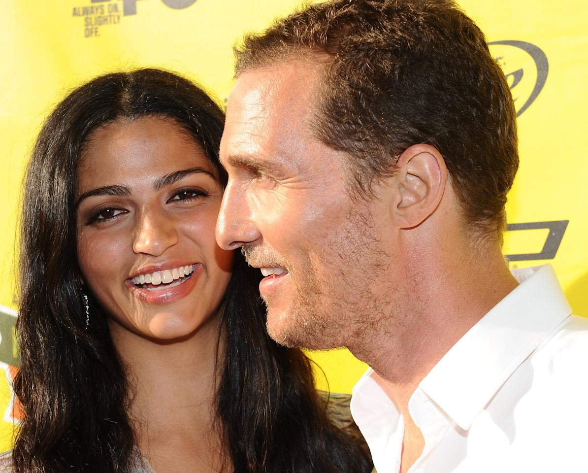 "AUSTIN, TX - MARCH 14:  Designer Camila Alves (L) and actor Matthew McConaughey arrive at the World Premiere of ""Bernie"" during the 2012 SXSW Music, Film + Interactive Festival at Paramount Theatre on March 13, 2012 in Austin, Texas.  (Photo by Michael Buckner/Getty Images for SXSW)"