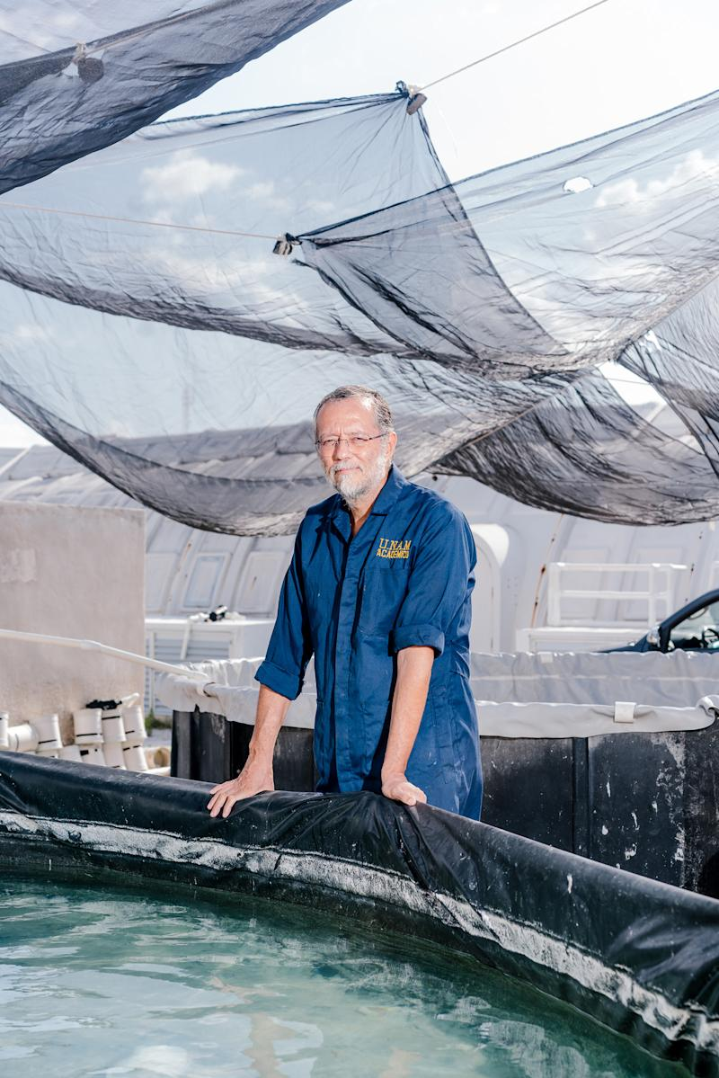 Dr. Carlos Rosas by one of the 24 octopus containers at his lab in Mexico's Yucatán Peninsula. | Jake Naughton for TIME