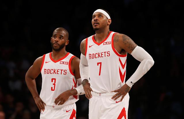 Chris Paul and Carmelo Anthony are tied by ousters from the Houston Rockets. (Jim McIsaac/Getty Images)