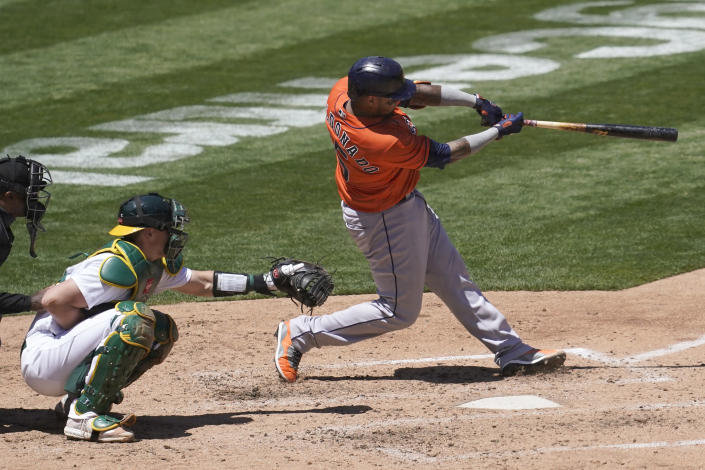 Houston Astros' Martin Maldonado, right, hits a two-run home run in front of Oakland Athletics catcher Sean Murphy during the fourth inning of a baseball game in Oakland, Calif., Thursday, May 20, 2021. (AP Photo/Jeff Chiu)