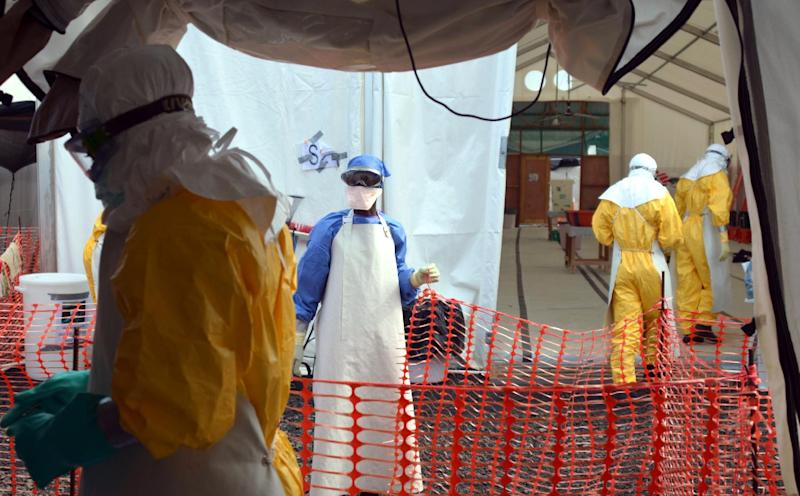 Liberian health workers at the NGO Medecins Sans Frontieres (Doctors Without Borders) Ebola treatment centre in Monrovia, on October 18, 2014 (AFP Photo/Zoom Dosso)