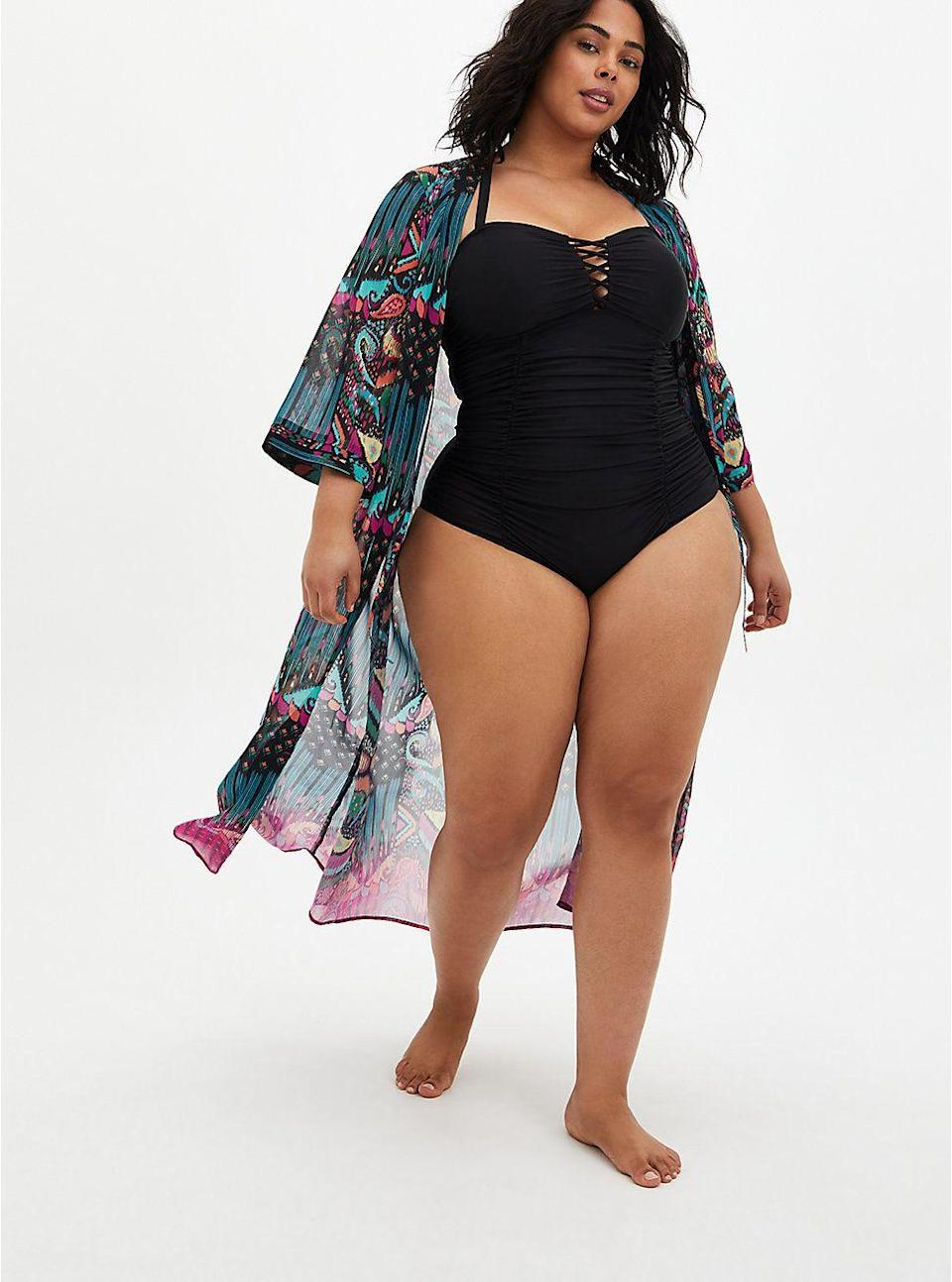 """<p><strong>Torrid</strong></p><p>torrid.com</p><p><strong>$45.15</strong></p><p><a href=""""https://go.redirectingat.com?id=74968X1596630&url=https%3A%2F%2Fwww.torrid.com%2Fproduct%2Fmulti-ikat-maxi-kimono-swim-cover-up-%2F14599137.html%3Fcgid%3DActiveSwim_Swim_CoverUps&sref=https%3A%2F%2Fwww.oprahdaily.com%2Fstyle%2Fg32771615%2Fbest-plus-size-swimsuit-cover-up%2F"""" rel=""""nofollow noopener"""" target=""""_blank"""" data-ylk=""""slk:SHOP NOW"""" class=""""link rapid-noclick-resp"""">SHOP NOW</a></p><p>Billowy sleeves, airy fabric, and a global-inspired print make this a winner. Tip: You can style this kimono over a tank and jeans for an effortless going-out look.</p>"""