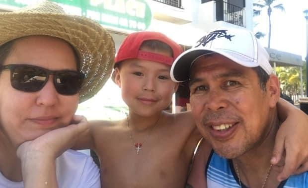 Judy Carlick-Pearson, left, her son Carver and her late husband Troy Pearson. Pearson died Feb. 11 after the tugboat Ingenika capsized while towing a barge in the Gardner Canal just off the coast of Kitimat.   (Photo submitted by Judy Carlick-Pearson. - image credit)