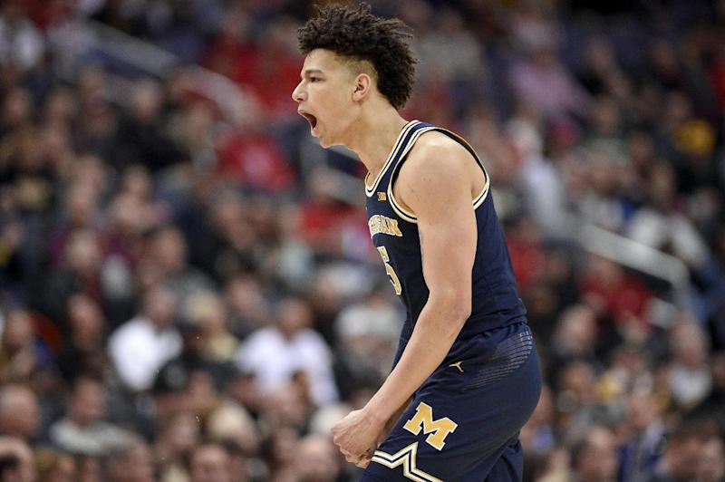 Michigan forward D.J. Wilson reacts during the first half of an NCAA college basketball game against Purdue in the Big Ten tournament, Friday, March 10, 2017, in Washington. (AP Photo/Nick Wass)
