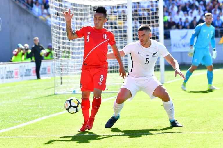 Peru's Christian Cueva (L) controls the ball next to New Zealand's Michael Boxall during their FIFA 2018 World Cup qualifying first leg match, at Westpac Stadium in Wellington, on November 11, 2017