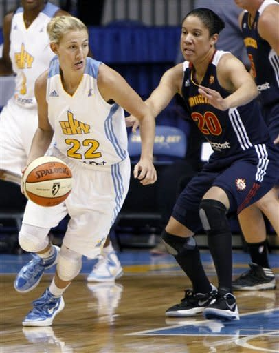 Chicago Sky's Courtney Vandersloo, left, looks to pass Connecticut Sun defender Kara Lawson during the first half of a WNBA basketball game on Tuesday, Aug. 28, 2012, in Rosemont, Ill. (AP Photo/Sitthixay Ditthavong)