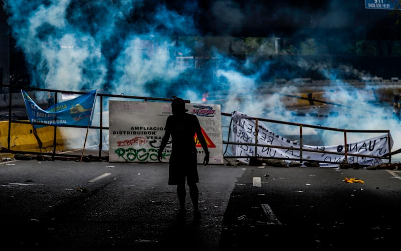 A demonstrator seen after clashes with the police - Credit: AFP
