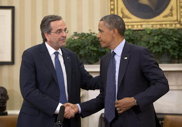 """President Barack Obama shakes hands with Greek Prime Minister Antonis Samaras during their meeting in the Oval Office of the White House in Washington, Thursday, Aug. 8, 2013. The White House said the meeting will """"underscore ongoing support for Greece's efforts to reform its economy and promote a return to prosperity.""""(AP Photo/Pablo Martinez Monsivais)"""