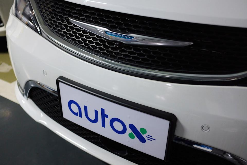 AutoX logo on a modified plate of a Chrysler Pacifica minivan in Shenzhen, Guangdong province, China. Photo: Yilei Sun/Reuters