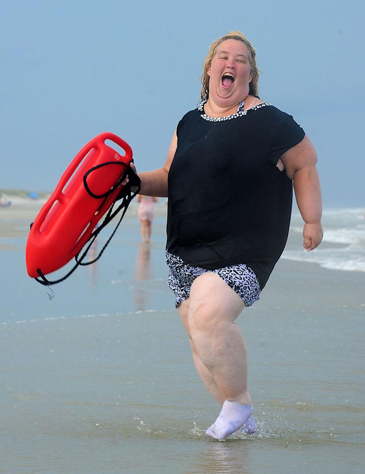 """EXCLUSIVE: **NO WEB until 1 pm PST June 12** Mama June Shannon runs on the beach with a lifeguard buoy in Tybee, GA. """"Honey Boo Boo"""" and family hit up the Tybee Island Beach in Georgia for a mini vacation. June wore sock on the beach due to her mangled foot from a fork lift accident. They call it the fork lift foot and thats why June is wearing her socks on the beach.   Pictured: """"Mama"""" June Shannon  Ref: SPL560575 120613  EXCLUSIVE  Picture by: Jason Winslow / Splash News     Splash News and Pictures  Los Angeles:310-821-2666  New York:212-619-2666  London:870-934-2666  photodesk@splashnews.com"""