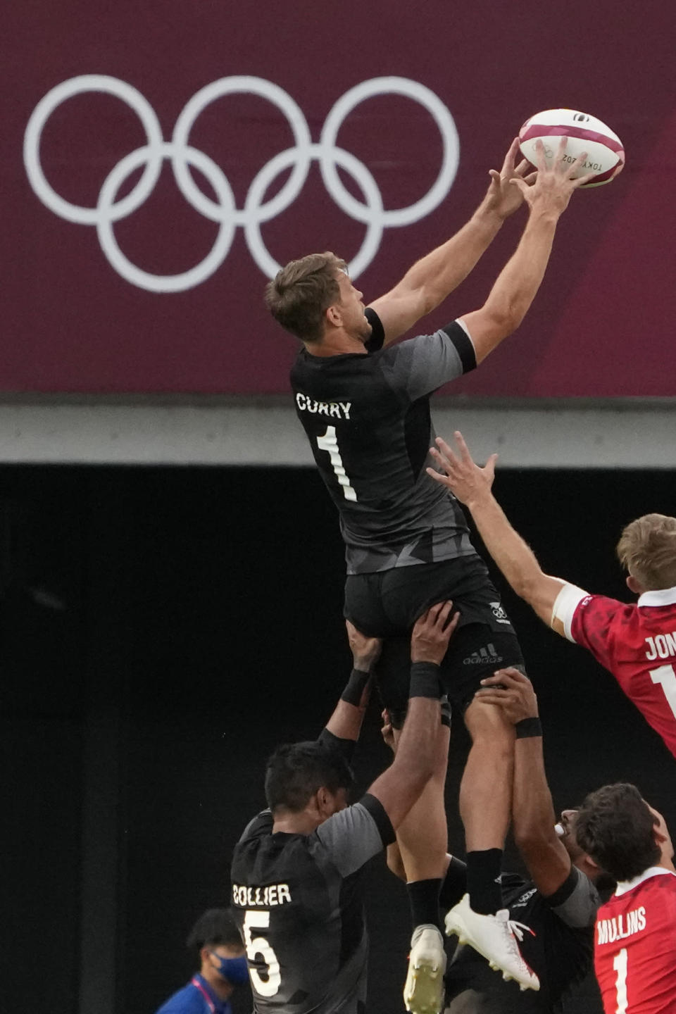 New Zealand's Scott Curry is lifted by teammates to catch the ball on a lineout, in their men's rugby sevens quarterfinal match against Canada at the 2020 Summer Olympics, Tuesday, July 27, 2021 in Tokyo, Japan. (AP Photo/Shuji Kajiyama)